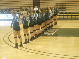 The Lady Lions Volleyball team prepared for the match.