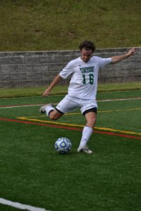 Sean Melton clears the ball from the Lion's territory.