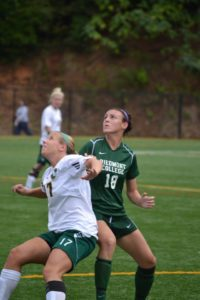 Freshman Megan Hatfield battles for the header.