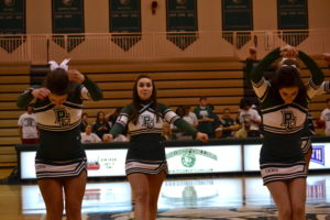 The cheerleading squad performed routines to pump up the crowd.