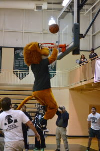 The PC Lion mascot participates in the dunk contest.
