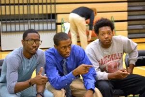 Safari Smith, Alton Honors, and Darius Wilson coach the Graduate Assistant team in the scrimmage