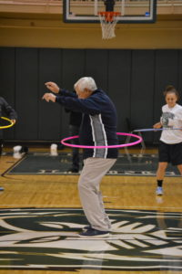 Piedmont Athletic Director, John Dzik, participates in the hula hoop contest.