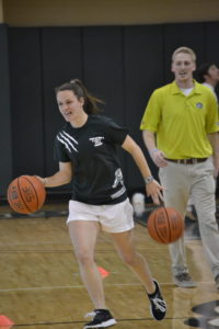 Cydney Goodwin dribbles down court as a part of a basketball skills challenge game.