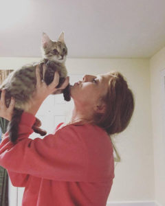 Senior biology major Sabrina Page lifts up another one of her cats, Giselle, when she was a kitten.